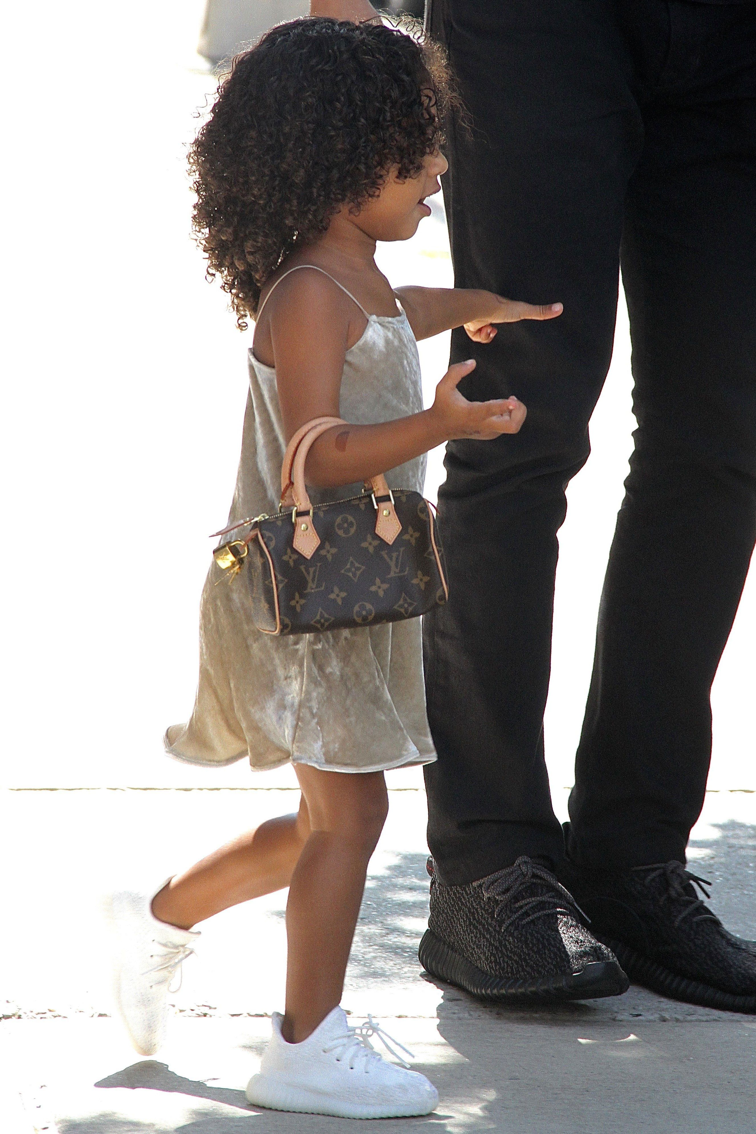 North West S Tiny Louis Vuitton Purse Costs More Than The Iphone 7 North West Kardashian Fashion Week Outfit Fashion