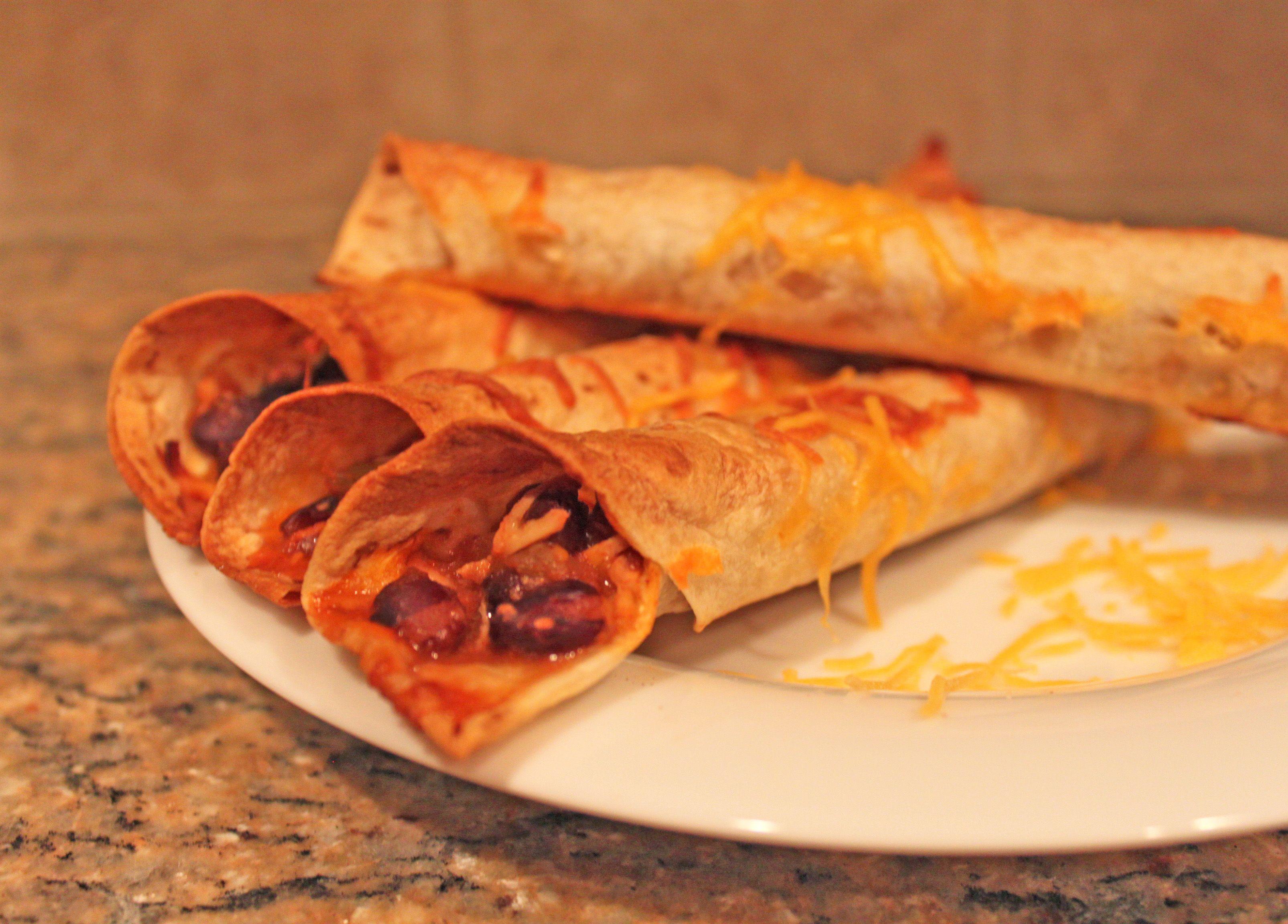 Semi-Slow Cooker Black Bean & Chicken Baked Taquitos | Little Kitchen, Big Bites