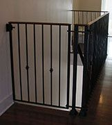 Delightful View Of A Custom Decorative Iron Baby Gate Made To Fit The Top Of Stairs.