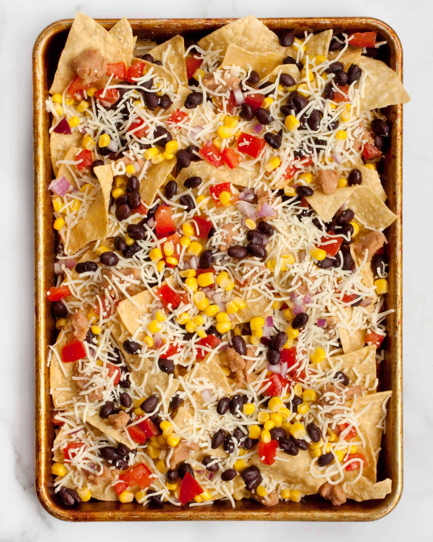 Sheet Pan Nachos With Black Beans, Corn And Tomatoes