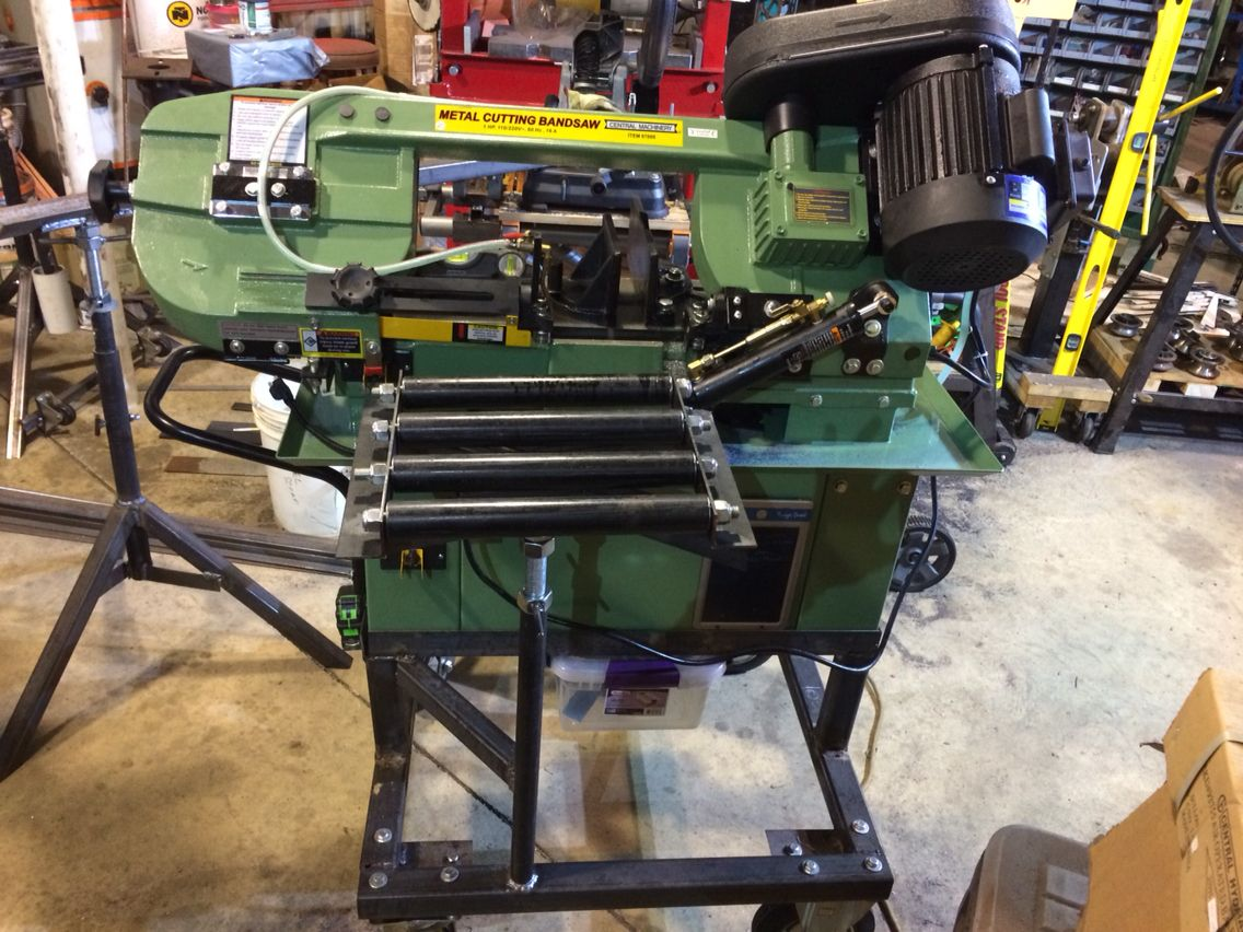 harbor freight bandsaw stand. metal bandsaw stand for a harbor freight hydrolic saw. raised the saw up to height