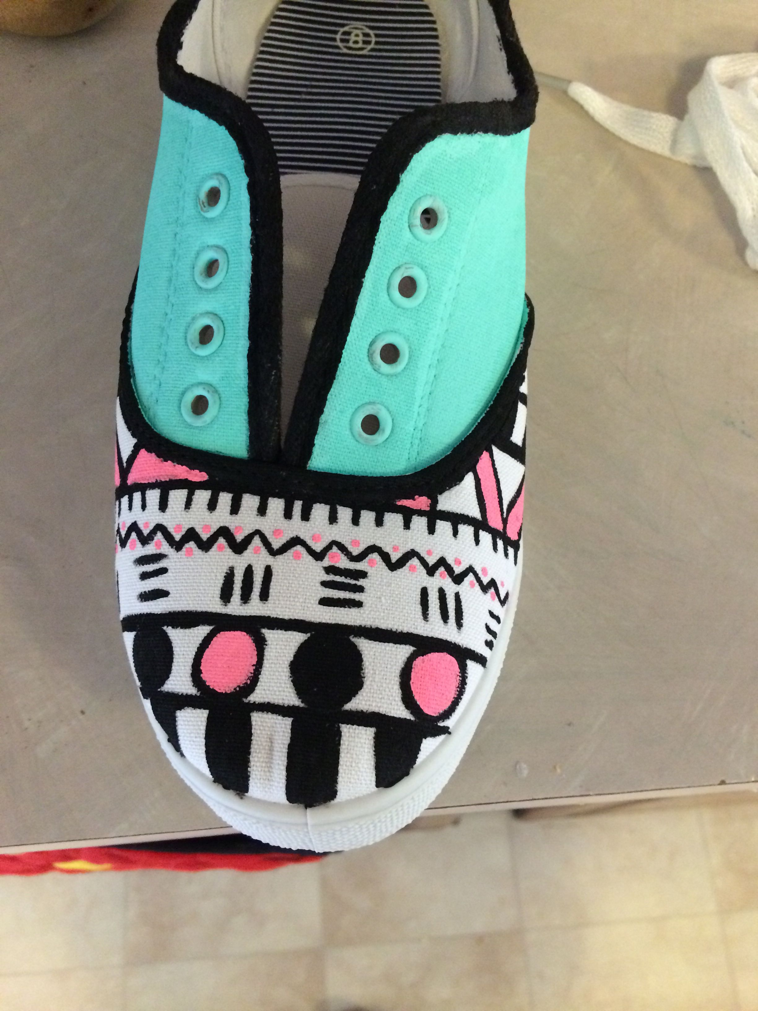 Geometric painted shoes. $25