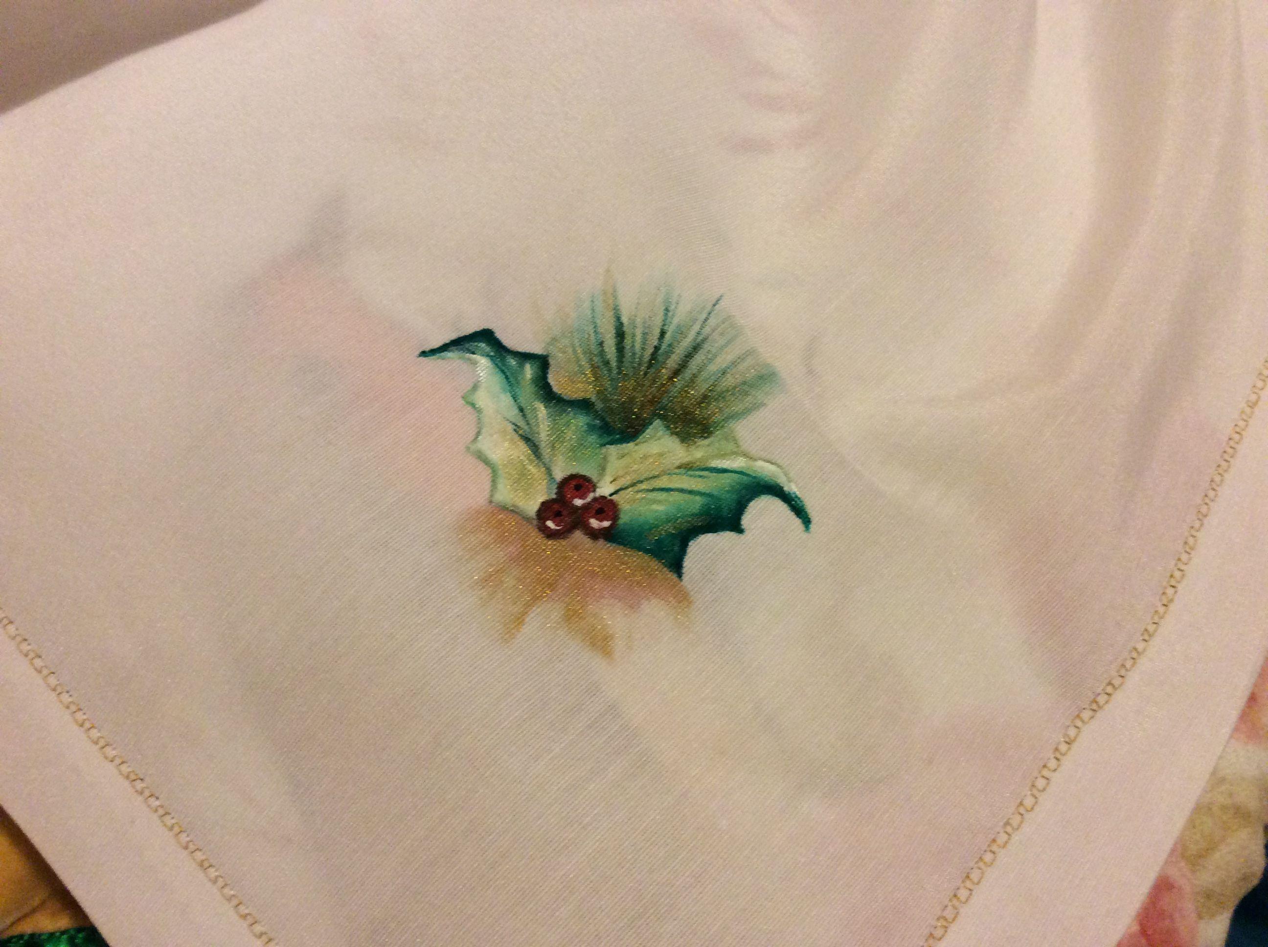Uns raminhos da toalha de mesa.