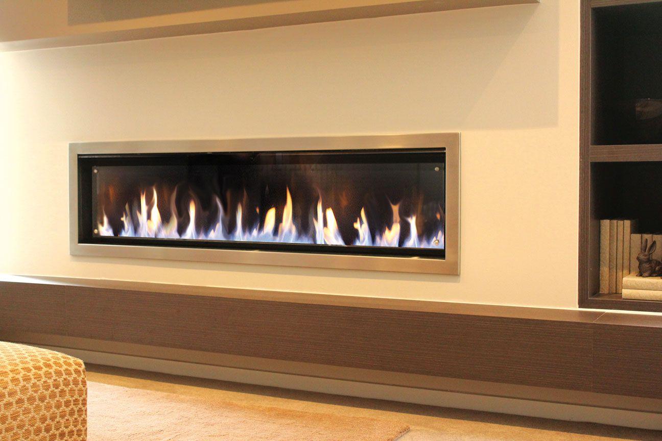 Interior Long Gas Fireplace Repair Around Orange Painted Wall ...