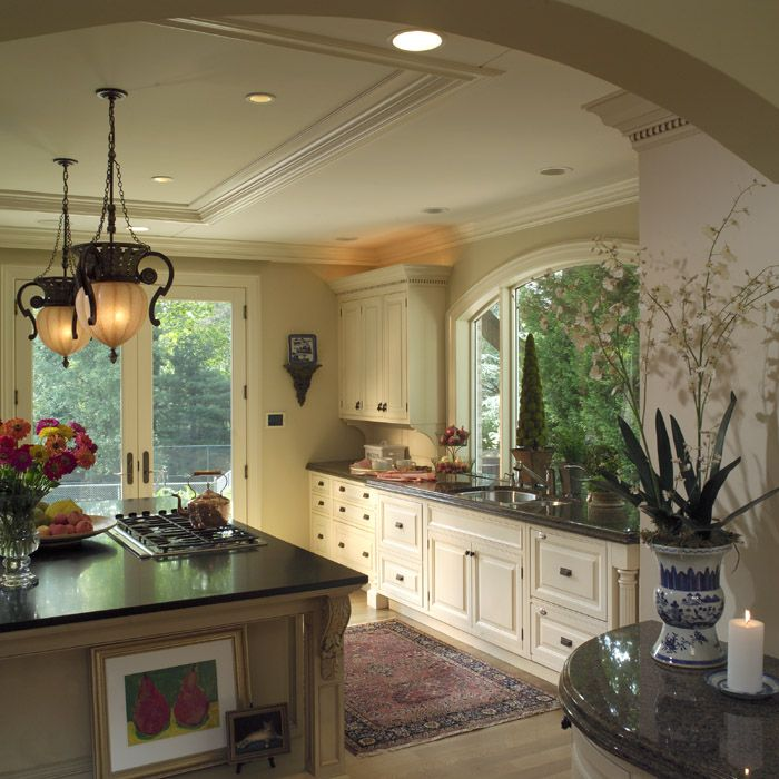 Traditional Kitchen. Large Sink Window. French Doors To Outside. Island  Pendant Lights. Black Stone Countertops.