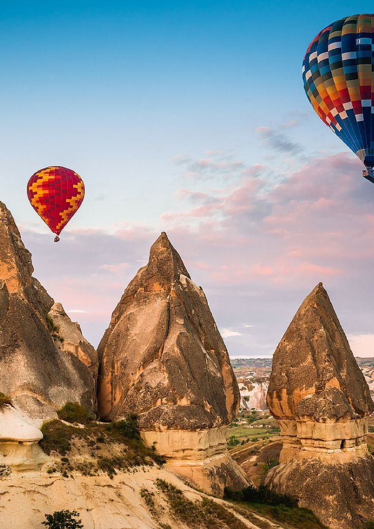 Check out some of the most AMAZING fairy tale travel destinations in the world!  Hot air balloon flying over Cappadocia region, Turkey