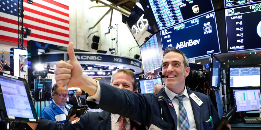 Nasdaq hits 10,000 for the first time ever, closes at