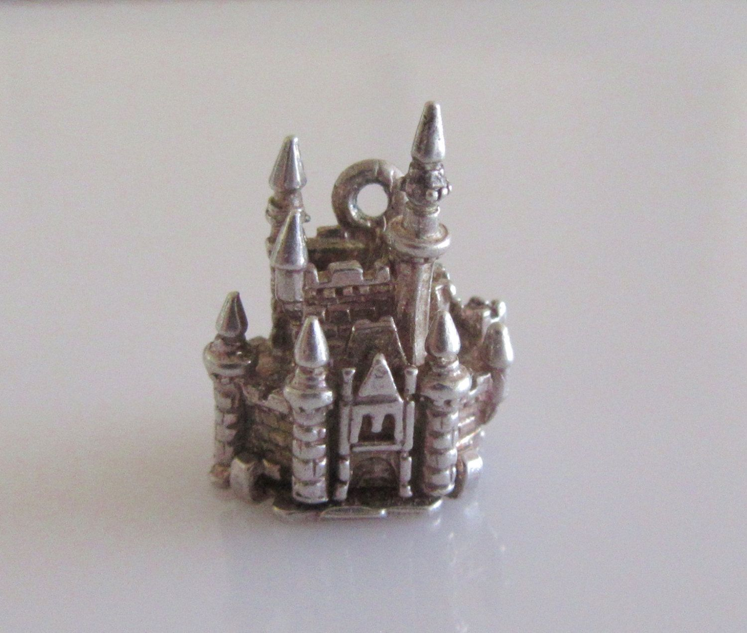 silver castle and mouse opening charm 25gbp