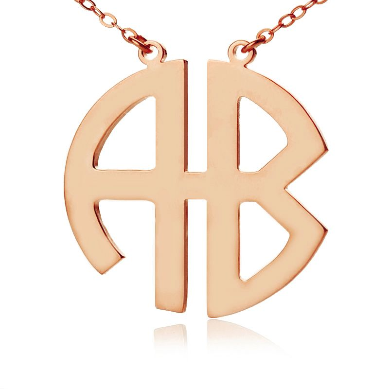 d3e7339eb This two letter silver monogram necklace offers an urban take on the  classic monogram pendant. Its design features block letters cut outs,  without a frame.