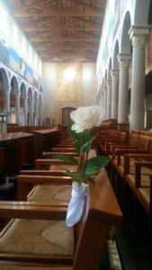 Belle's rose marks her seat in chapter order in the Church of the Transfiguration at the Community of Jesus