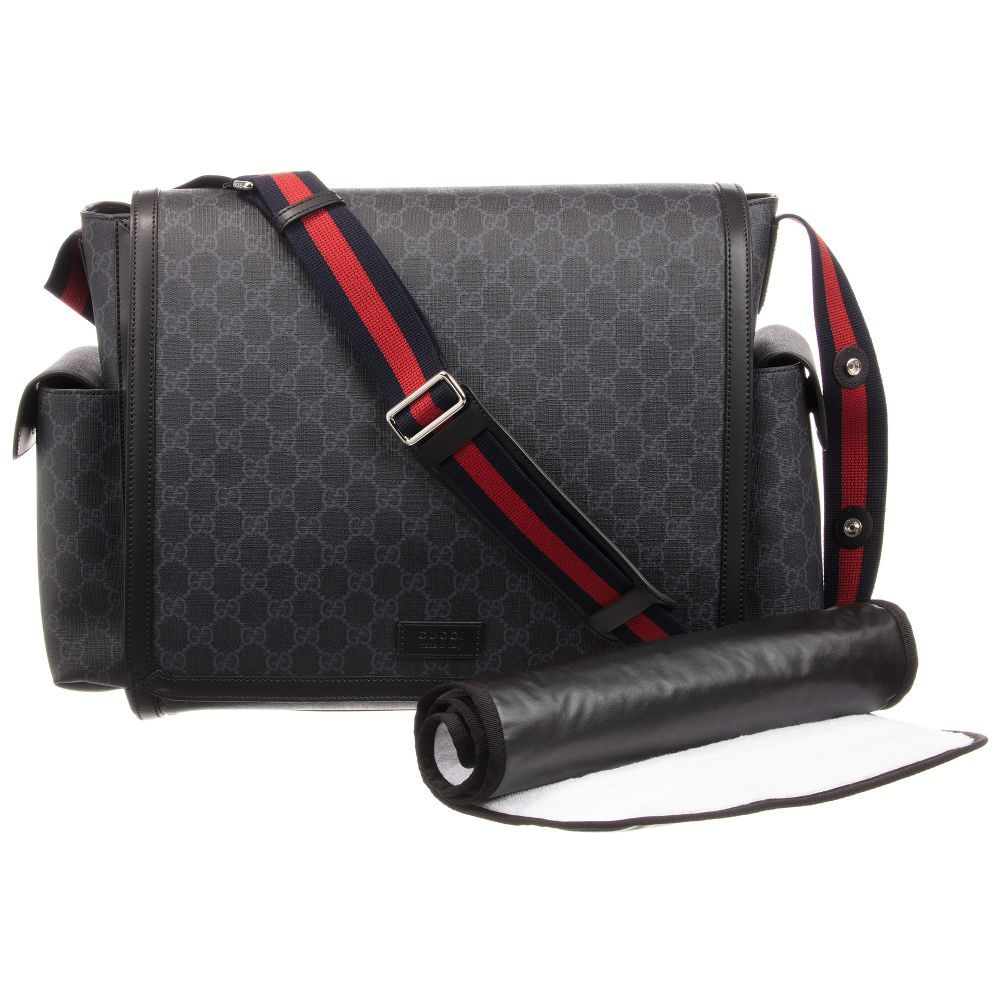 cdfbe09fba9f Gucci  GG  Logo Changing Bag (44cm). Shop from an exclusive selection of  designer Bags. Black and grey Supreme canvas baby ...