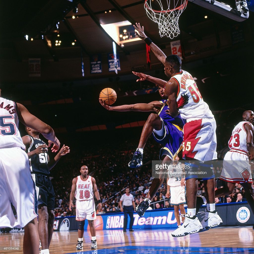 Kobe Byrant #8 of the Los Angeles Lakers shoots against Dikembe Mutombo #55 of the Atlanta Hawks during the 1998 NBA All-Star Game played on February 8, 1998 at Madison Square Garden in New York City.