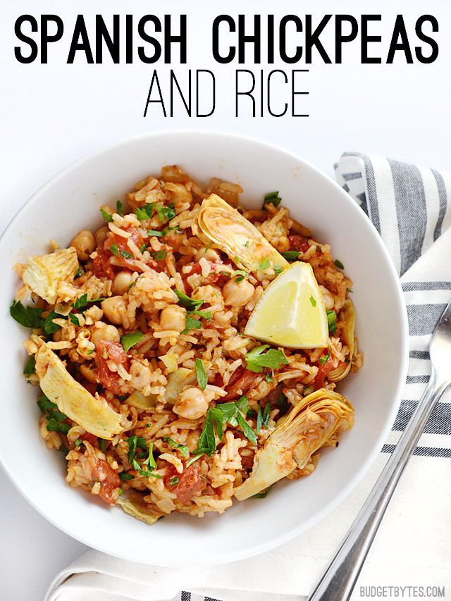 This one pot Spanish Chickpeas and rice has big flavor thanks to liberal dose of spices, artichoke hearts, and fresh lemon. Step by step photos. @budgetbytes