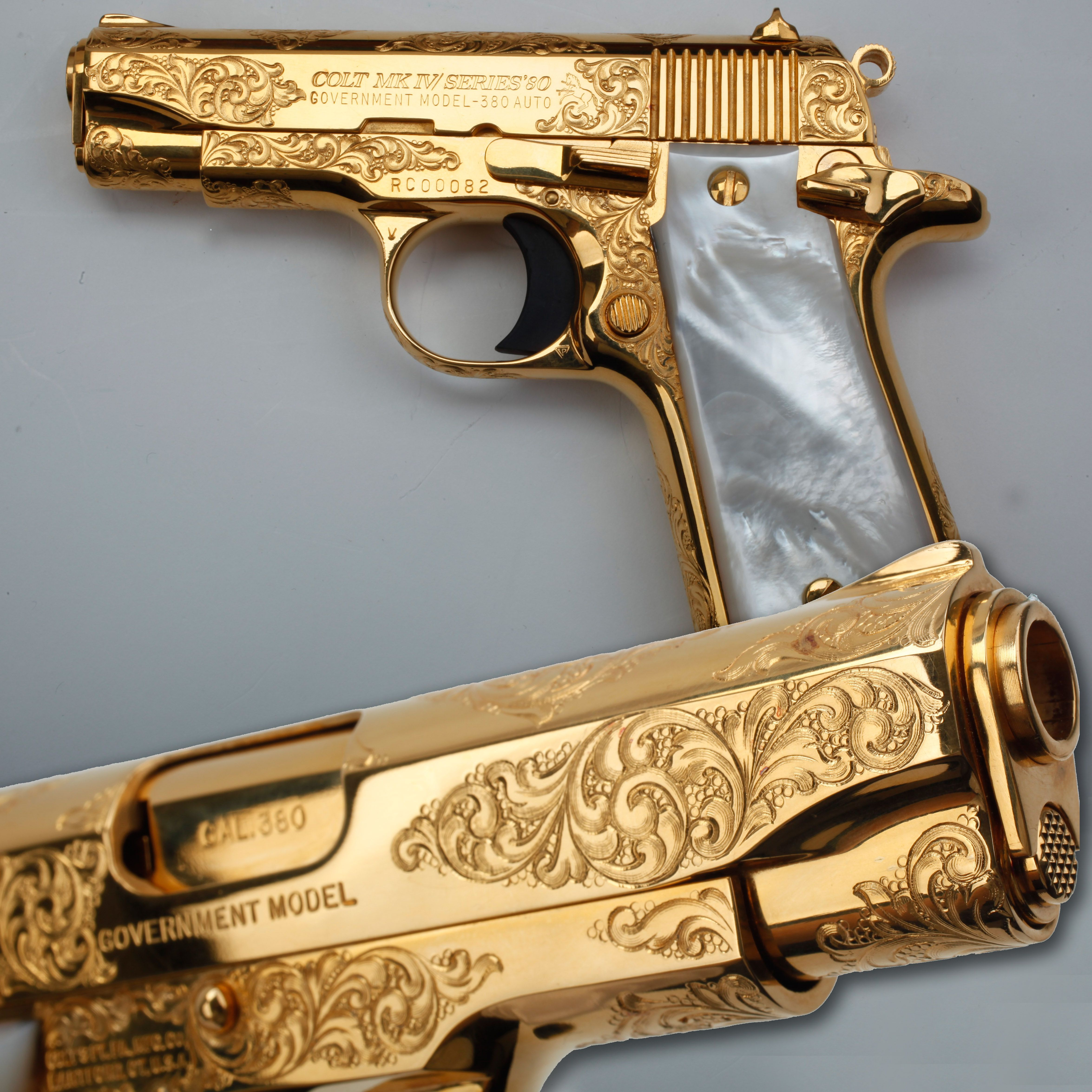 """""""A Golden Colt - Our GOTD Colt .380 Government is pretty close to the size of a Christmas tree ornament and with its factory engraving and mother-of-pearl grip panels, this diminutive pistol is a good reminder of the maxim that """"good things come in small packages."""" This pistol is on display as part of the Robert E. Petersen Gallery at the NRA National Firearms Museum in Fairfax, VA."""""""