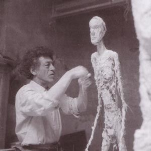 Alberto Giacometti (1901-1966) one of the outstanding artists of the 20th Century.  He came from a family of artists and produced the majority of his paintings and sculpture in Paris.  He was influenced by cubism, surrealism, existentialism and phenomenology, and was dominated by his unceasing search for the essence of existence.  He found fame with his sculptures featuring excessively long figures which were very thin and often very tall.