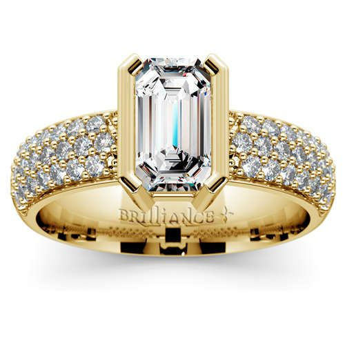 Flip that ring box open and watch her marvel at the charm of the Half Bezel Diamond Engagement Ring in classic Yellow Gold, featuring an exquisite Emerald-cut center diamond and 38 shimmering pave-set round diamonds! http://www.brilliance.com/engagement-rings/half-bezel-diamond-ring-yellow-gold-3/8-ctw