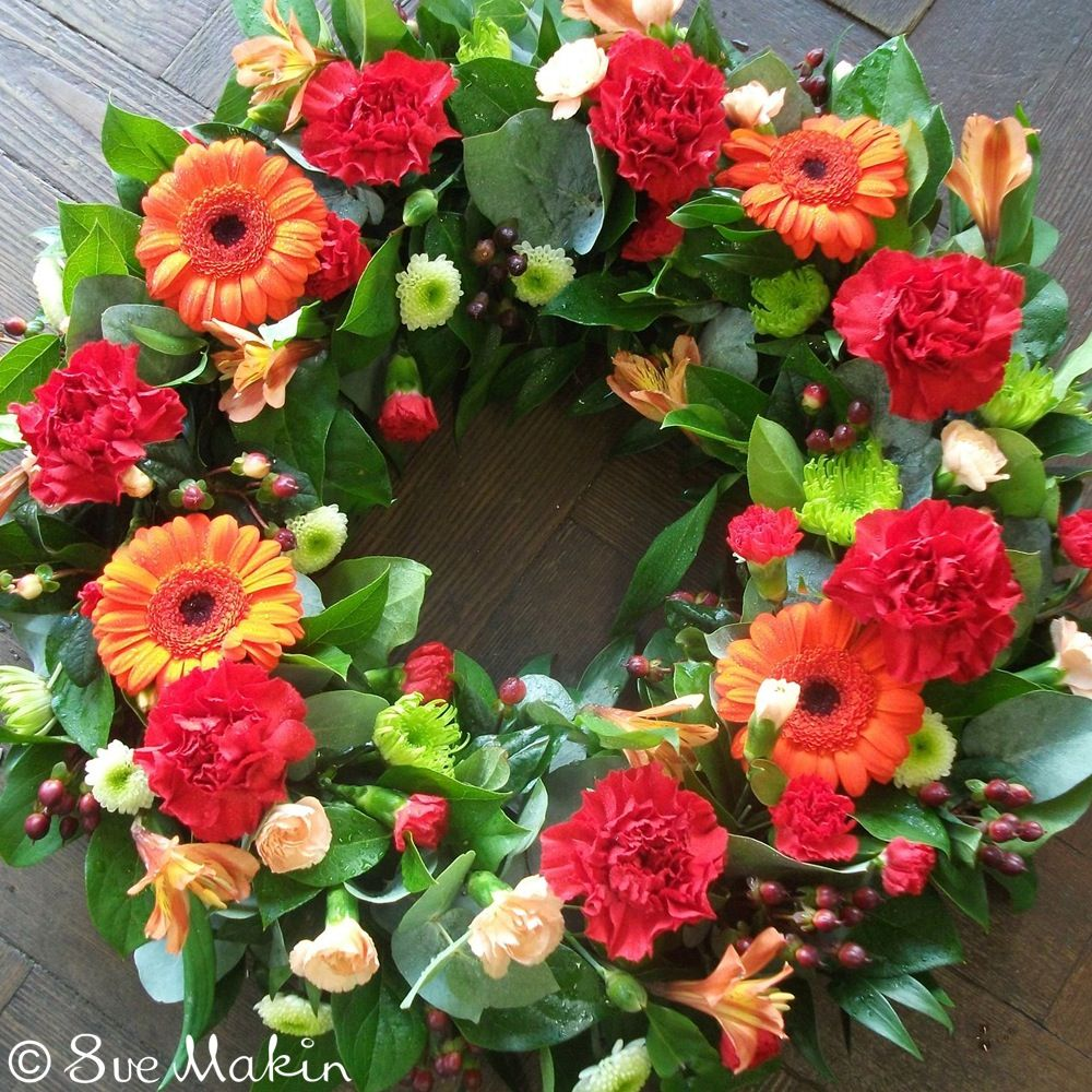 Open Wreath In Red And Orange Red Carnation Gerbera And Carnation
