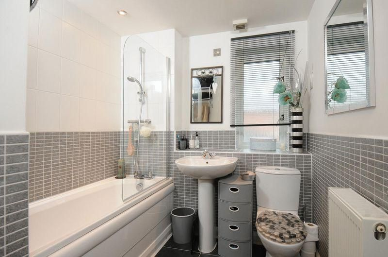 photo of calming clean modern beige grey white bathroom with blind mirror tiles