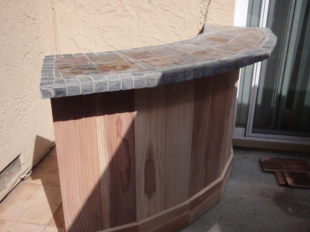 outside bar style tile on top wood on bottom patio