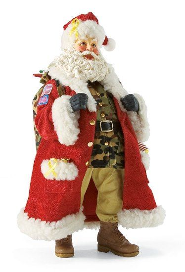 GI Santa-This 11 inch Santa is dressed in camoflouge and is adorned with yellow ribbons and American flags. He is ready to be proudly displayed in a place of honor in your home. GI Santa displays his respect to all who have served through his camoflage attire tucked beneath his traditional red coat decorated with yellow ribbons and patches of honor.