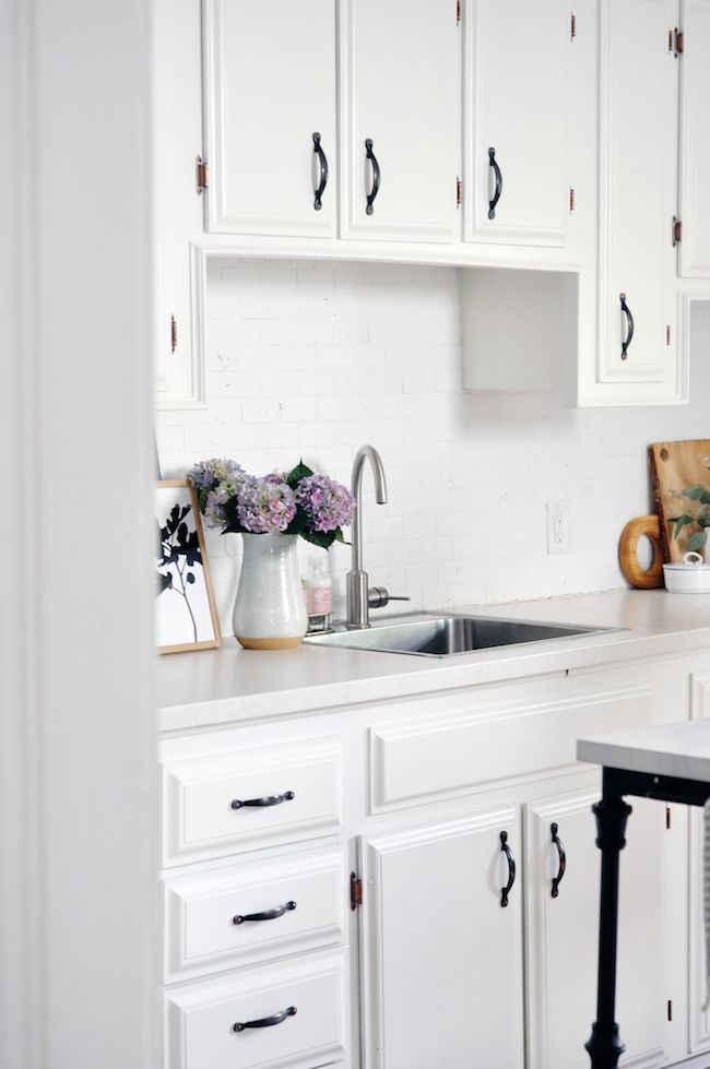 White framed kitchen cabinets with black hardware | KITCHEN + DINING ...