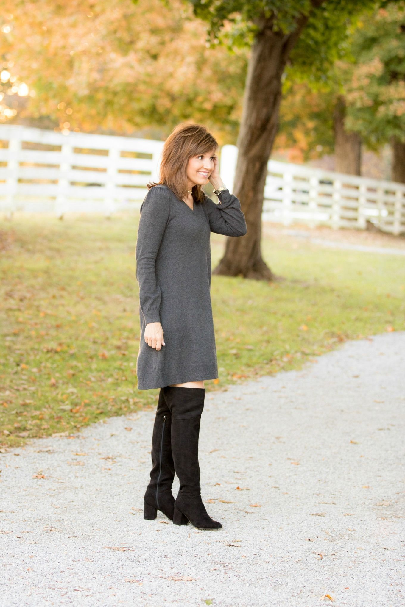 cff272b0adc5 Fashion blogger Cyndi Spivey styling a sweater dress from Loft.