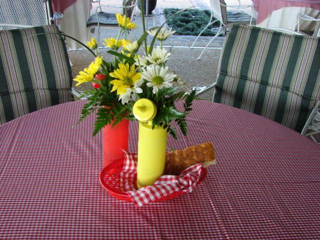 Condiment bottle floral table centerpieces for picnic