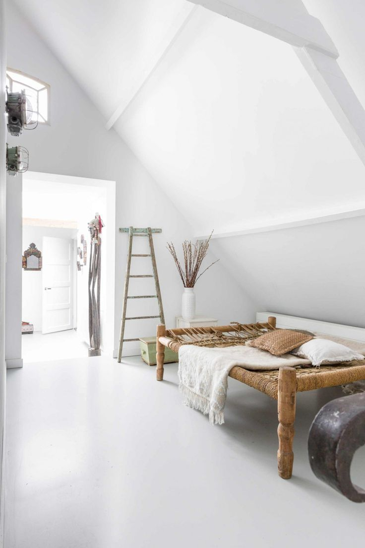 Beautiful white living space and daybed