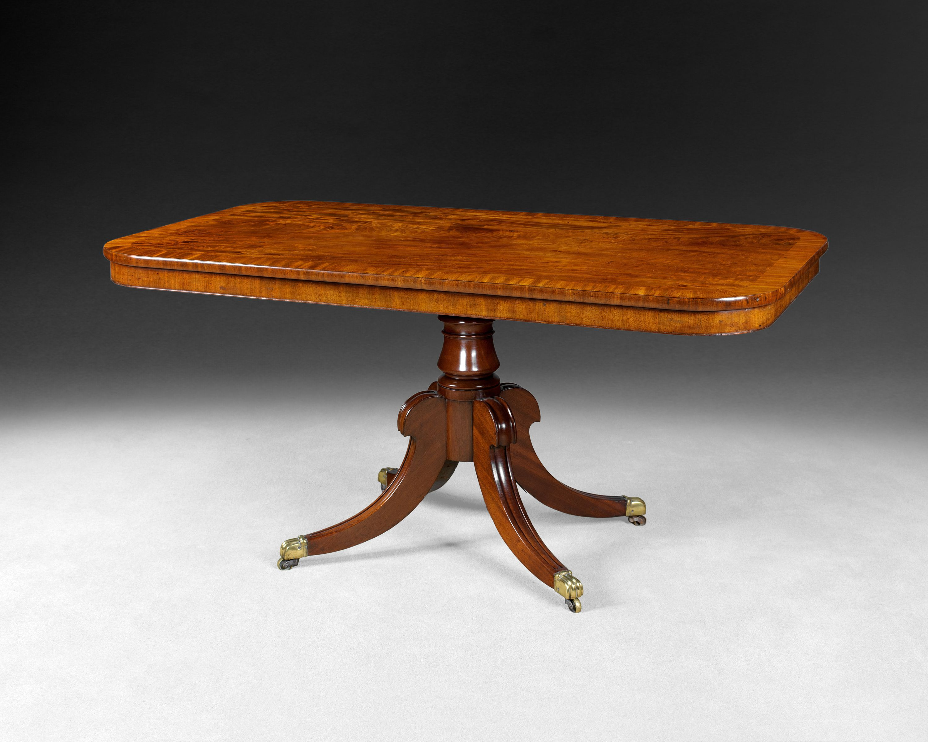A Particularly Good Regency Period Mahogany Breakfast Table The Rectangular Fiddle Back And Flame Figured Crossbanded Tilting Top Above Column