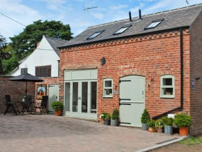 This former coach house is set within the peaceful and