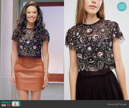 2807e8ecdec421 Kibby s black embellished crop top on Daytime Divas. Outfit Details   https