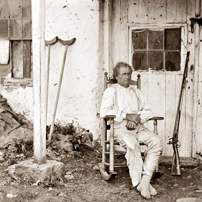 "Gettysburg, Pennsylvania  John L. Burns, the ""old hero of Gettysburg,"" with gun and crutches"