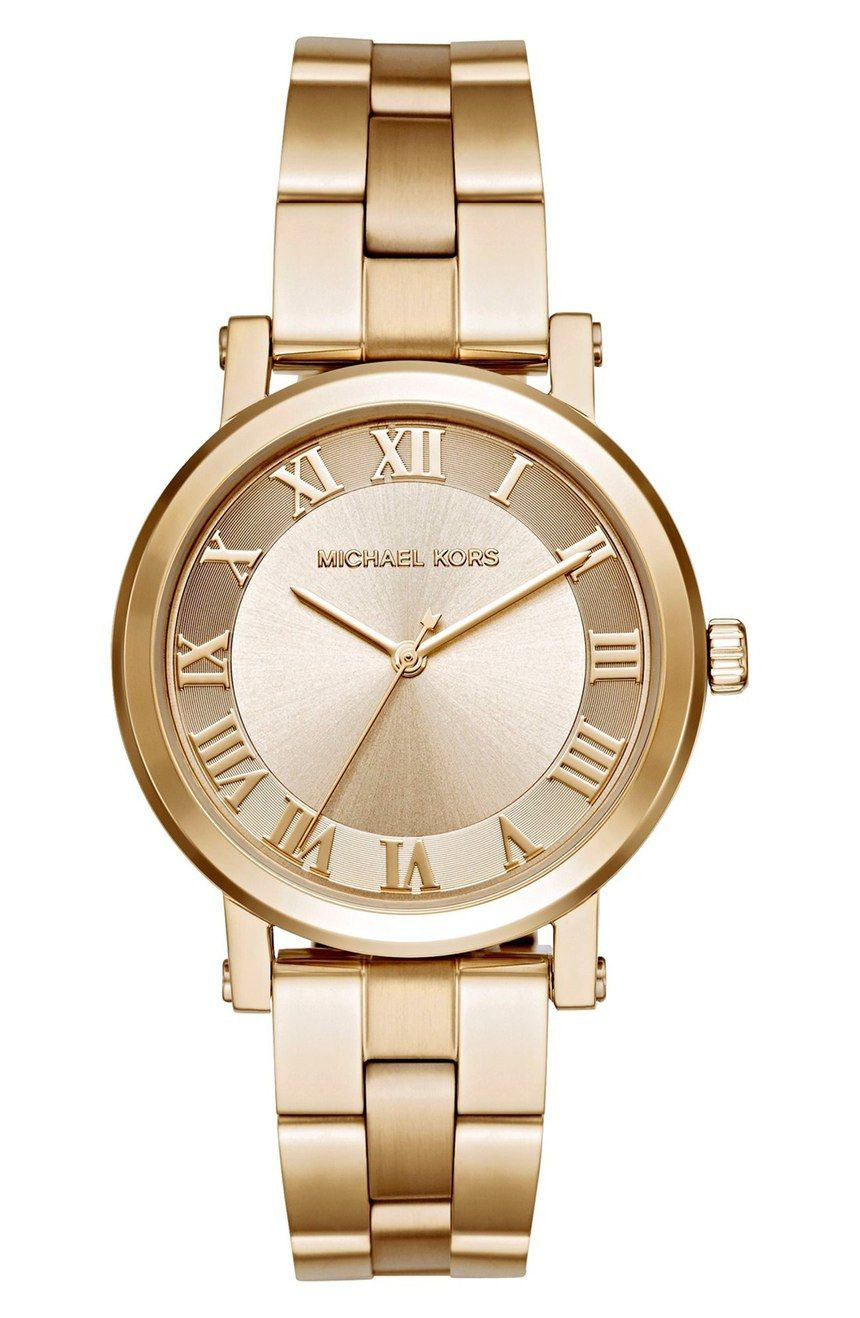 Crushing on this classic gold Michael Kors watch. Worn alone or stacked  with bracelets ecea122671bd
