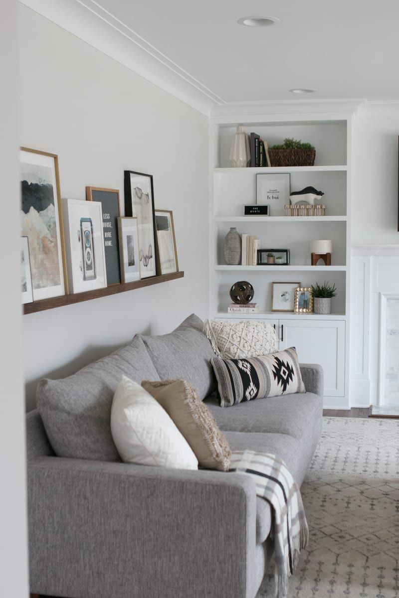 DIY Picture Ledge Over the Couch Filled with Art | The DIY Playbook