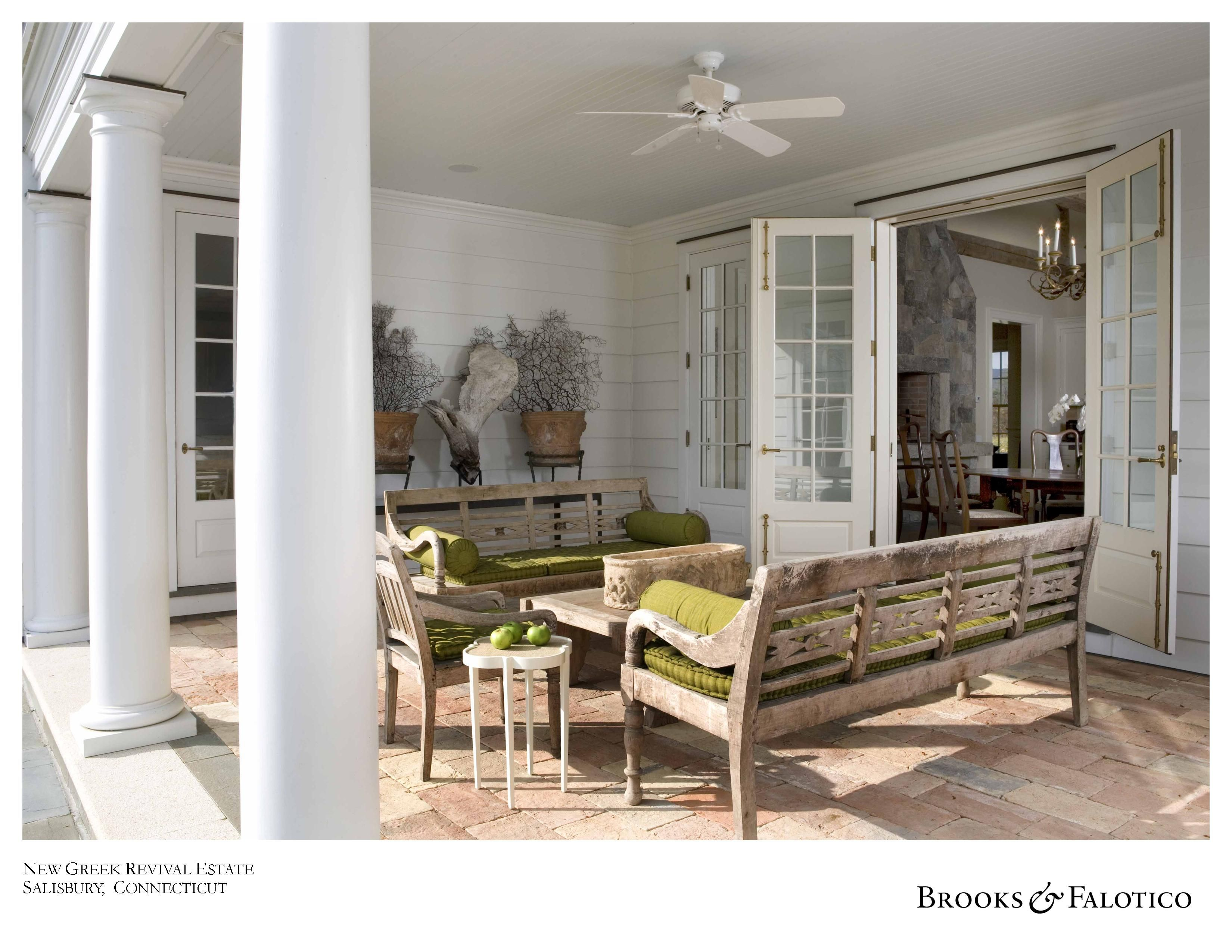 Covered porch give this home presence and style rustic brick