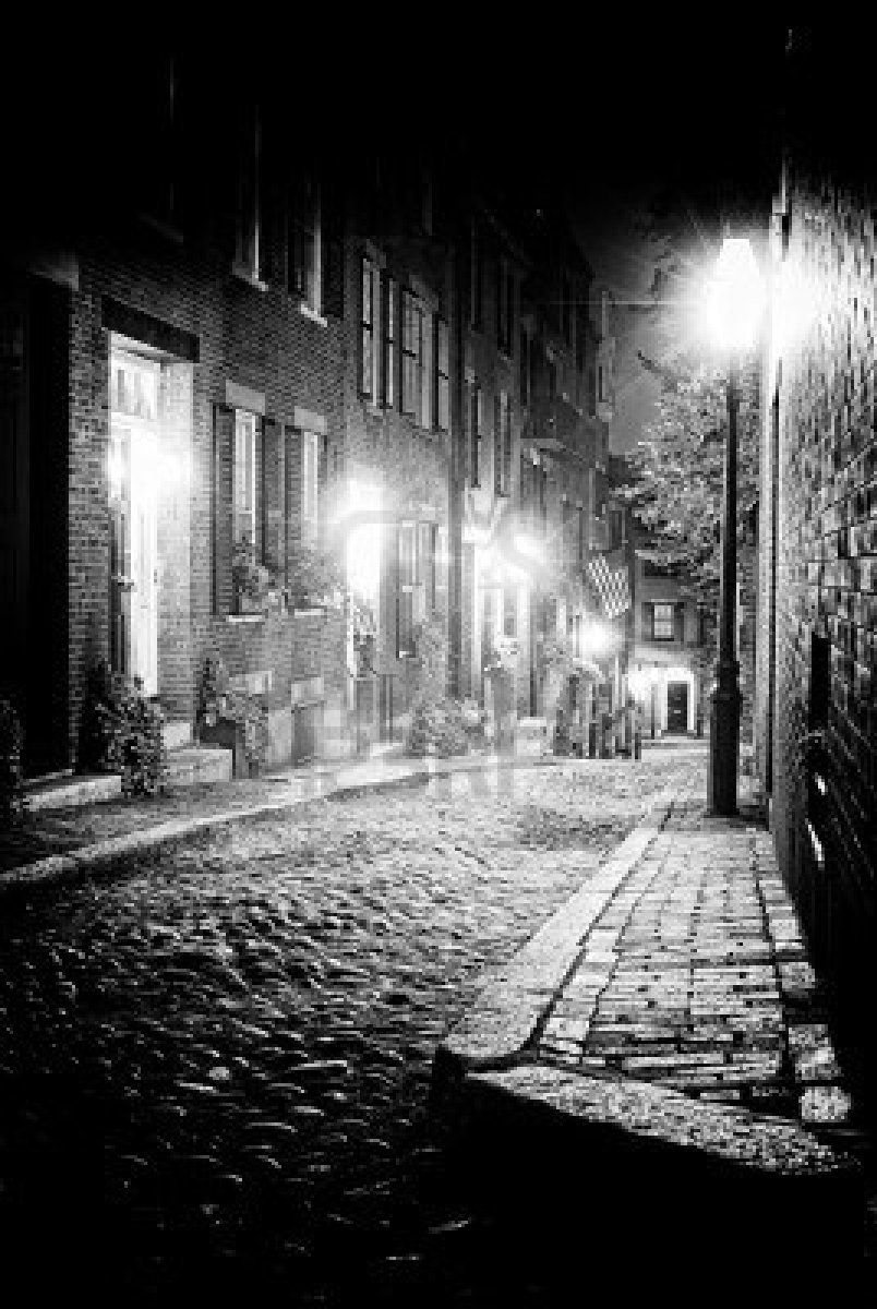 Black and white night image of an old 19th century cobble stone road in boston massachusetts acorn street stock photo 10595081