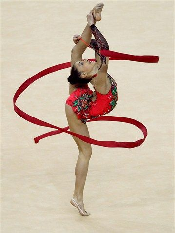 Ribbon apparatus of the Individual All-Around  Jana Berezko-Marggrander of Germany in action in the Individual All-Around during the FIG Rhythmic Gymnastics Olympic Qualification event.