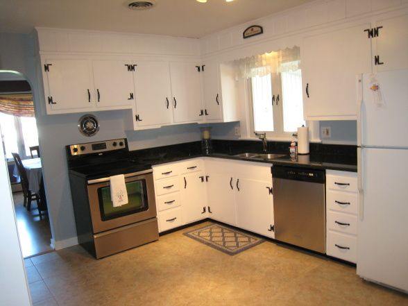 Redone knotty pine kitchen painted cabinets look pretty for Cost to update kitchen cabinets and countertops