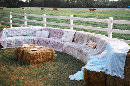 Buy straw hay bales at Tractor Supply stores and cover them with quilts or  blankets to make a super-comfy lounge seating area at your wedding!