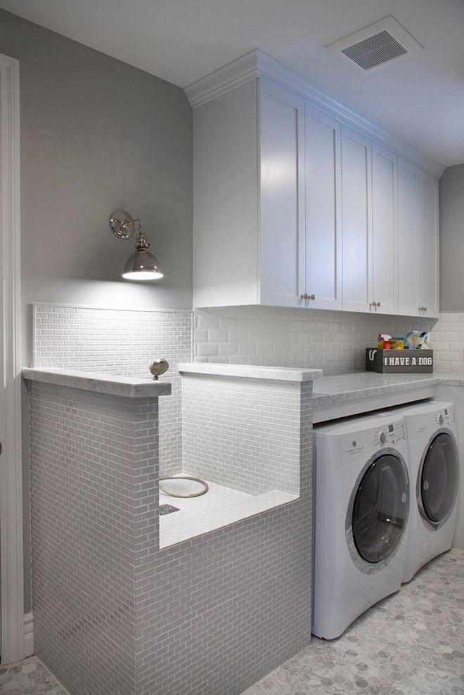 This stunning laundry room features white cabinets and a very practical pet  shower and grooming stationThis stunning laundry room features white cabinets and a very  . Dog Bathing Table. Home Design Ideas