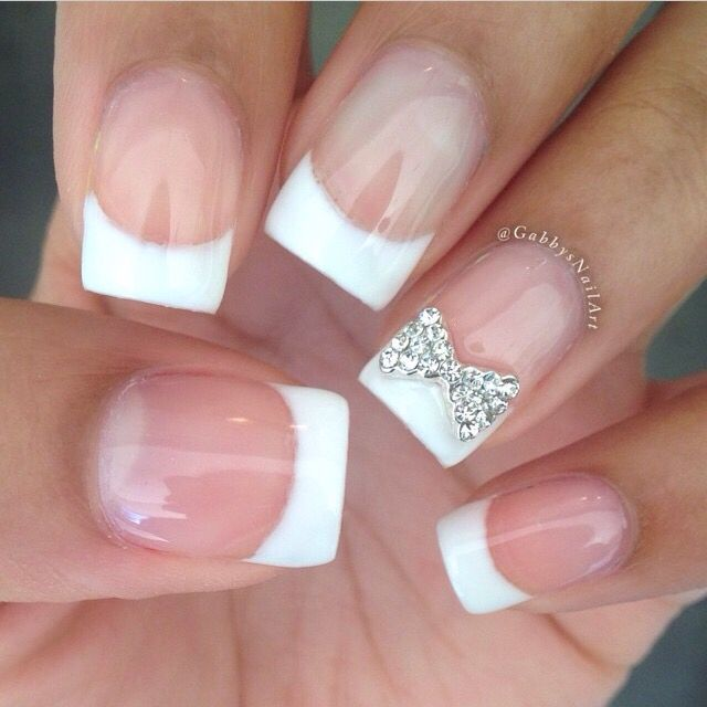 Cute and simple french tip with a bow done by @GabbysNailArt on ...