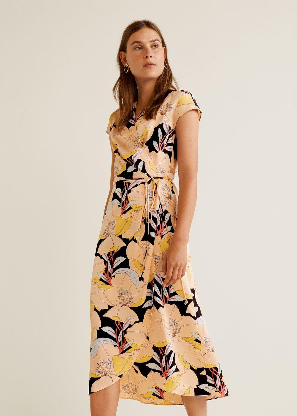 6a6a575d90 Crossover design Flowy fabric Floral print Crossed V-neck Short sleeve Cord  fastening Asymmetric hem