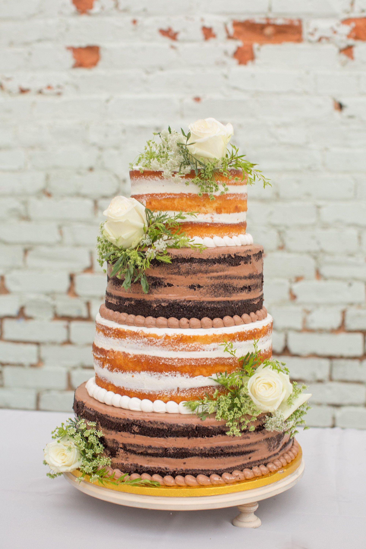 Chocolate vanilla naked cake with white flowers naked cake chocolate vanilla naked cake with white flowers naked cake inspiration southern wedding cake inspiration an auburn alabama wedding at the railyard by mightylinksfo