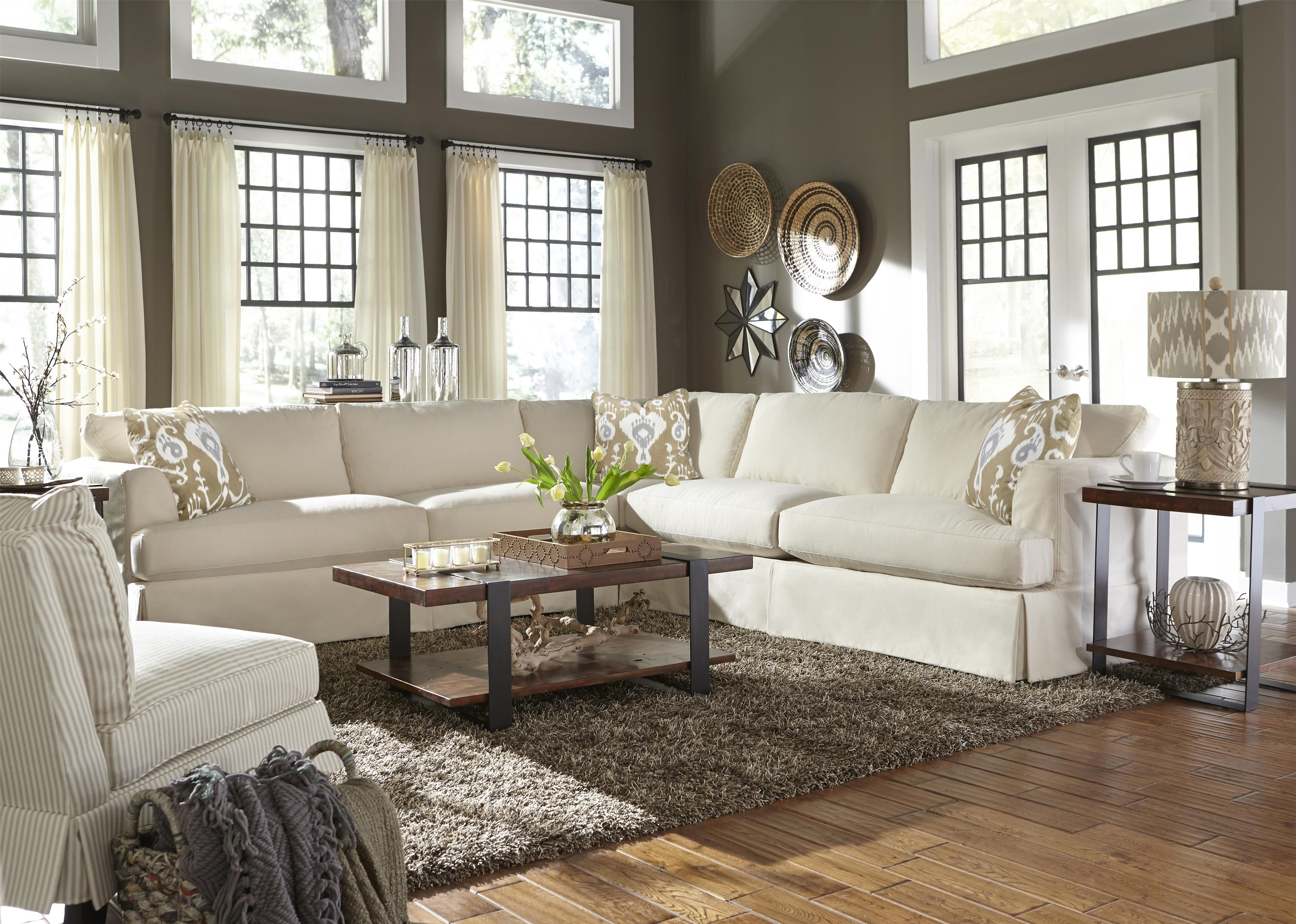 This Slip Covered Sectional Sofa Offers