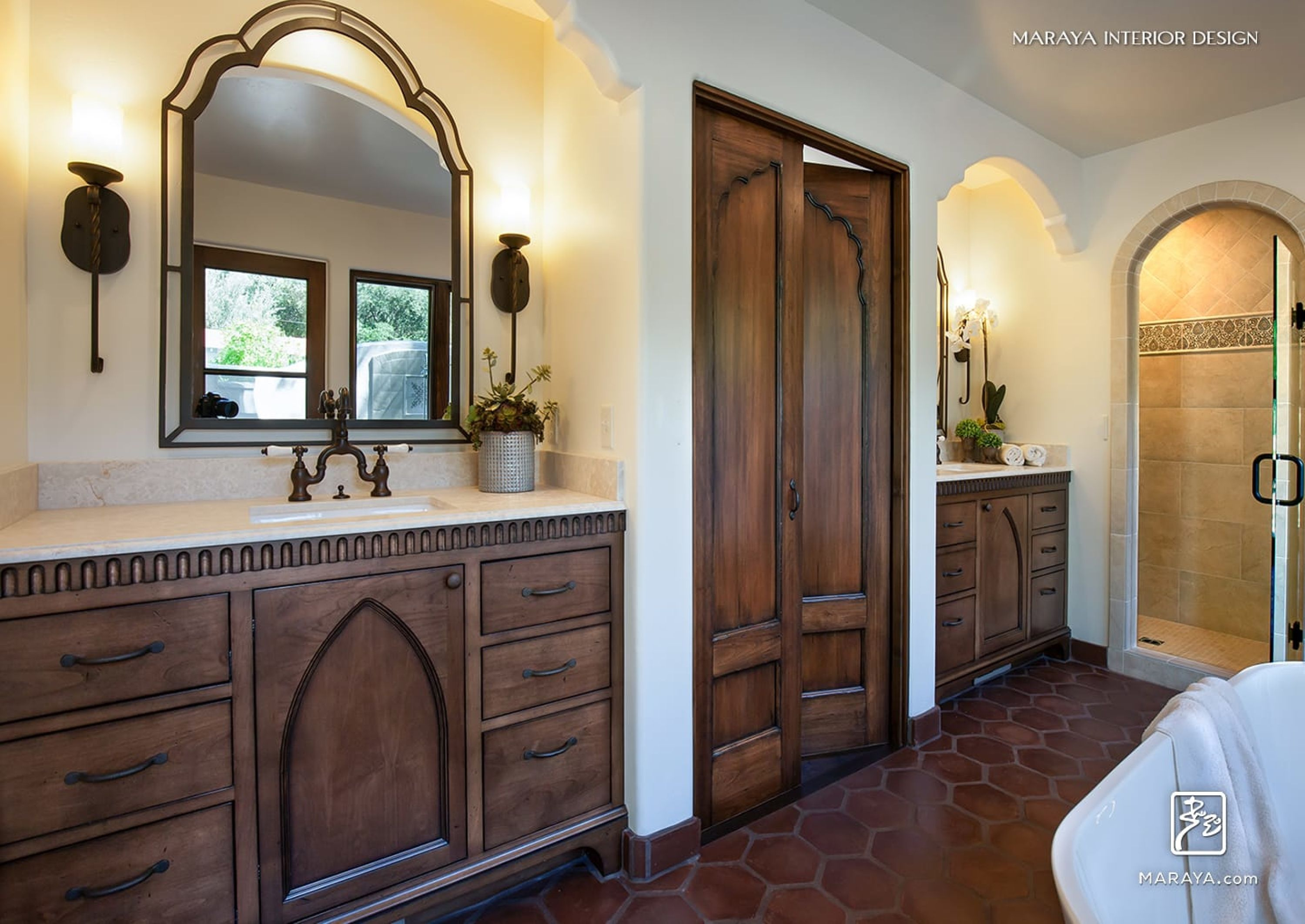 spanish master bath with indian antique design doors carved
