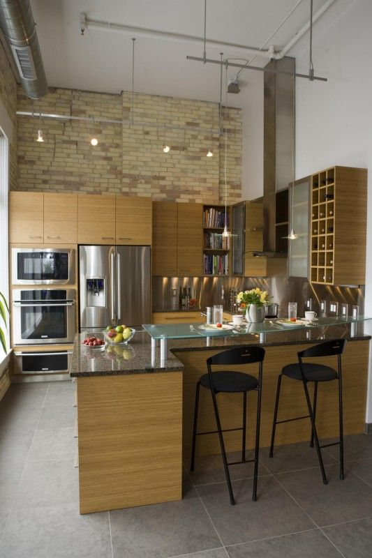 A contemporary kitchen with industrial flare. High ceilings are ...