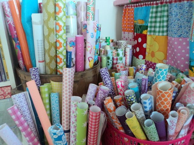 Store wrapping paper in large round storage basket/bucket