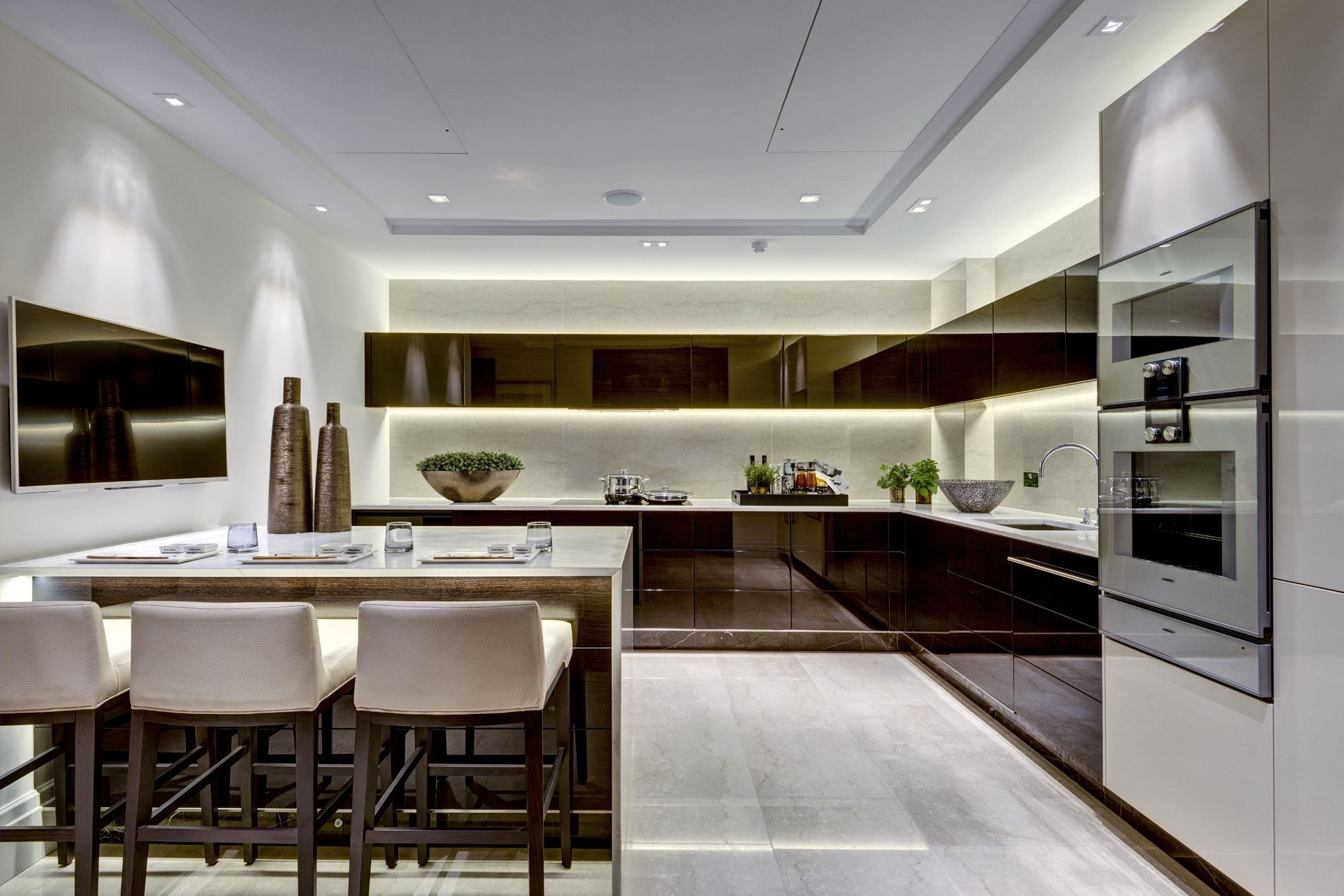 Sleek luxurious contemporary kitchen in London apartment