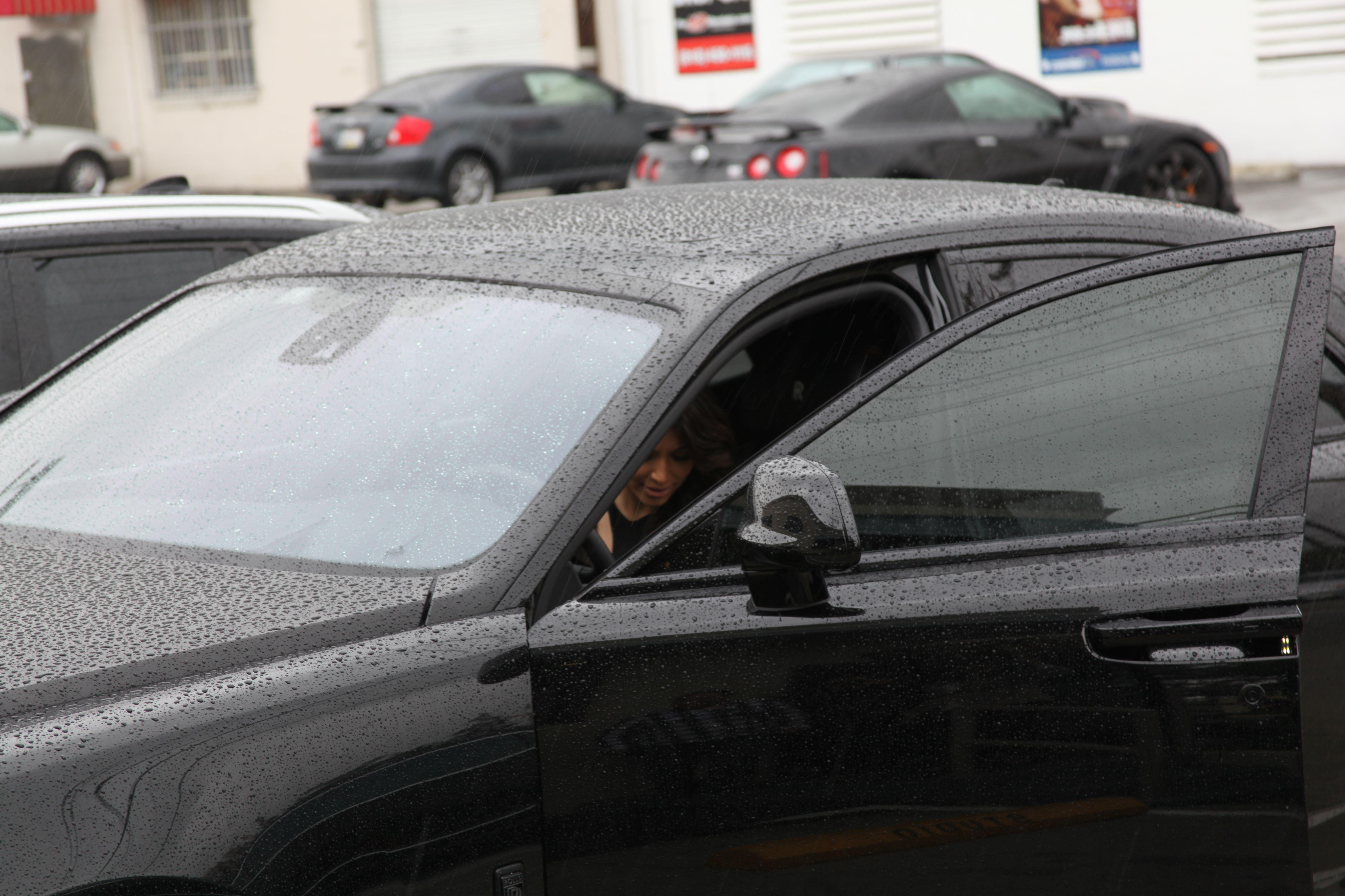 Kim Kardashian Arrives In Her Matte Black Rolls Royce At Loyal