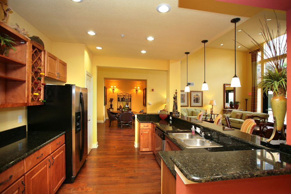 Yellow Walls And Gorgeous Marble Countertops Yellow Kitchen Walls Yellow Kitchen Brown Kitchen Cabinets